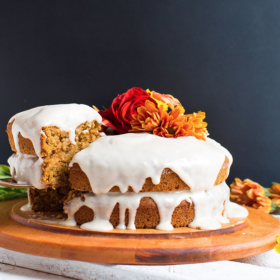 Removing a slice of gluten-free vegan Pumpkin Cake from a cutting board