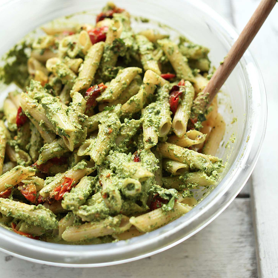 Bowl of our delicious Pesto Pasta Salad with sun-dried tomatoes