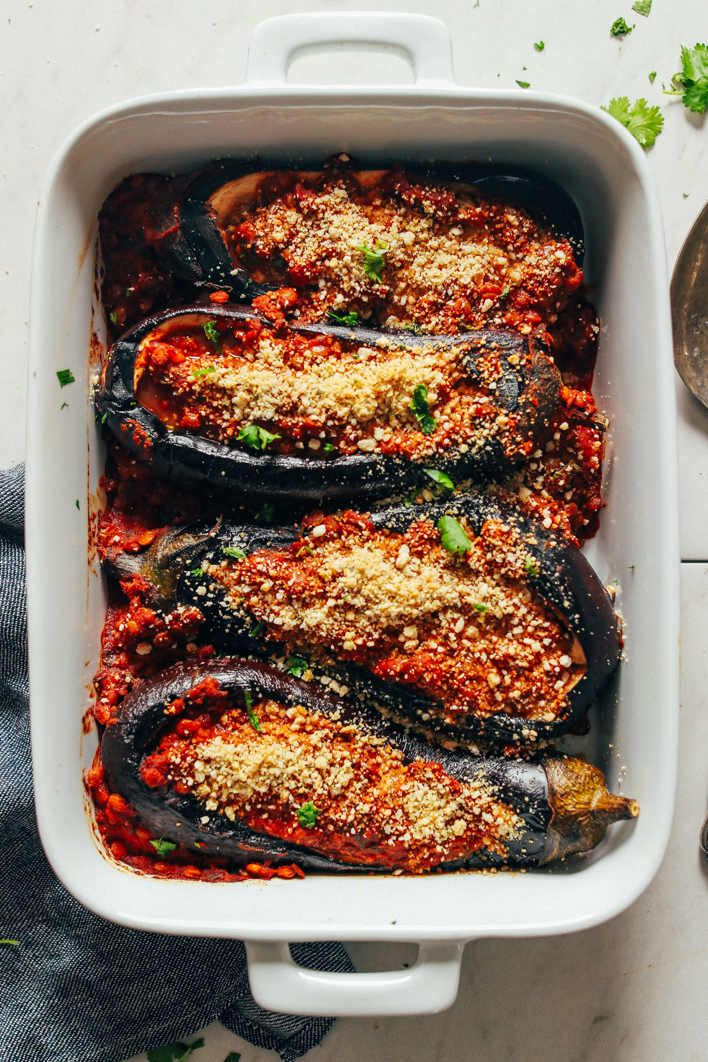 Ceramic baking dish with Moroccan Lentil-Stuffed Eggplant for a healthy plant-based meal
