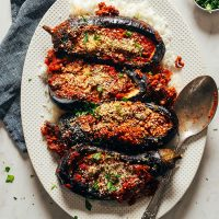 Platter of four Moroccan-Spiced Lentil Stuffed Eggplants