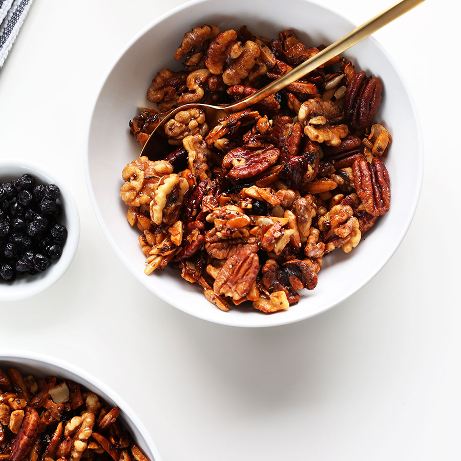 Bowl of Grain-Free Granola packed with pecans, walnuts, and dried wild blueberries