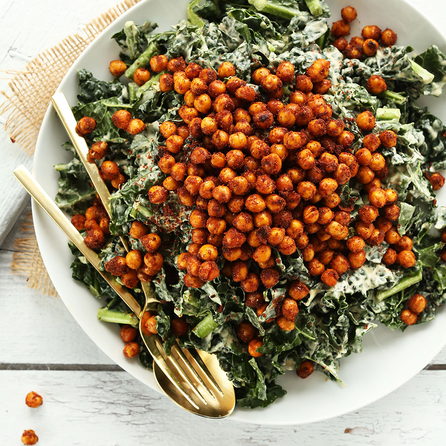 Large dinner plate piled with Garlicky Kale Salad with Tandoori Chickpeas
