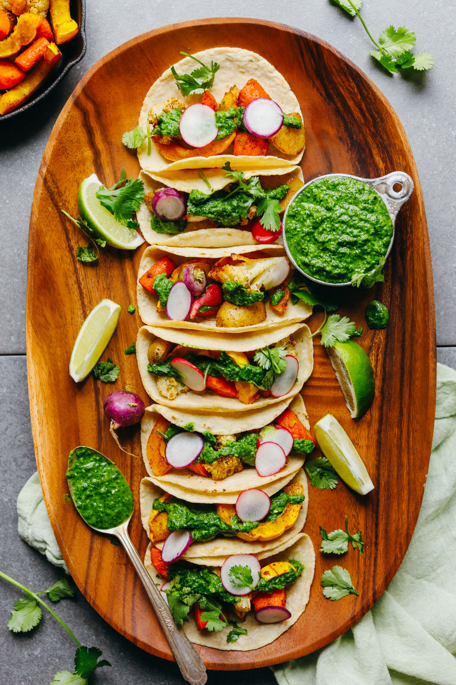 A large platter filled with gluten-free 30-Minute Roasted Vegetable Tacos with Chimichurri