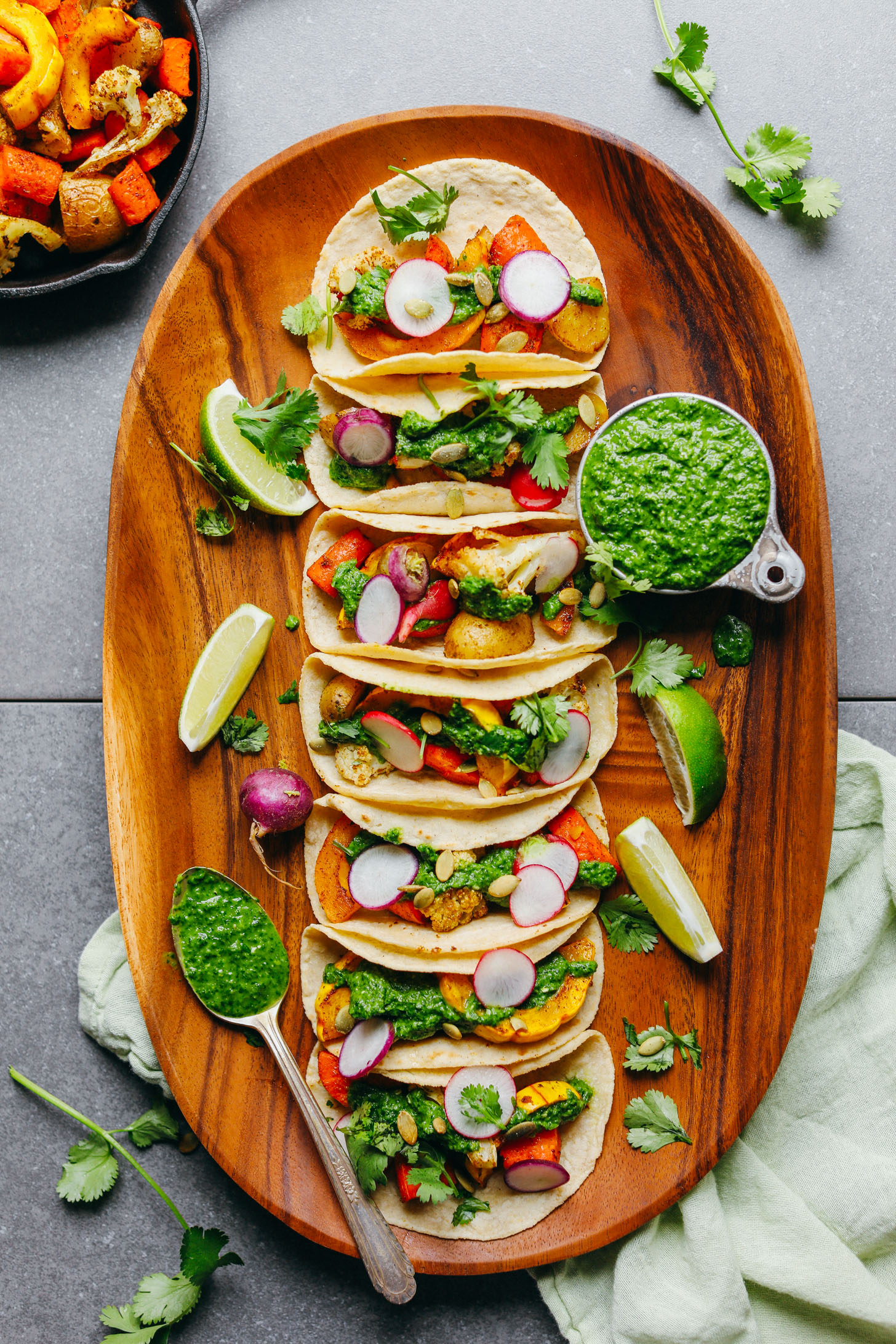 A large platter filled with 30-Minute Roasted Vegetable Tacos with Chimichurri for a healthy gluten-free, plant-based meal