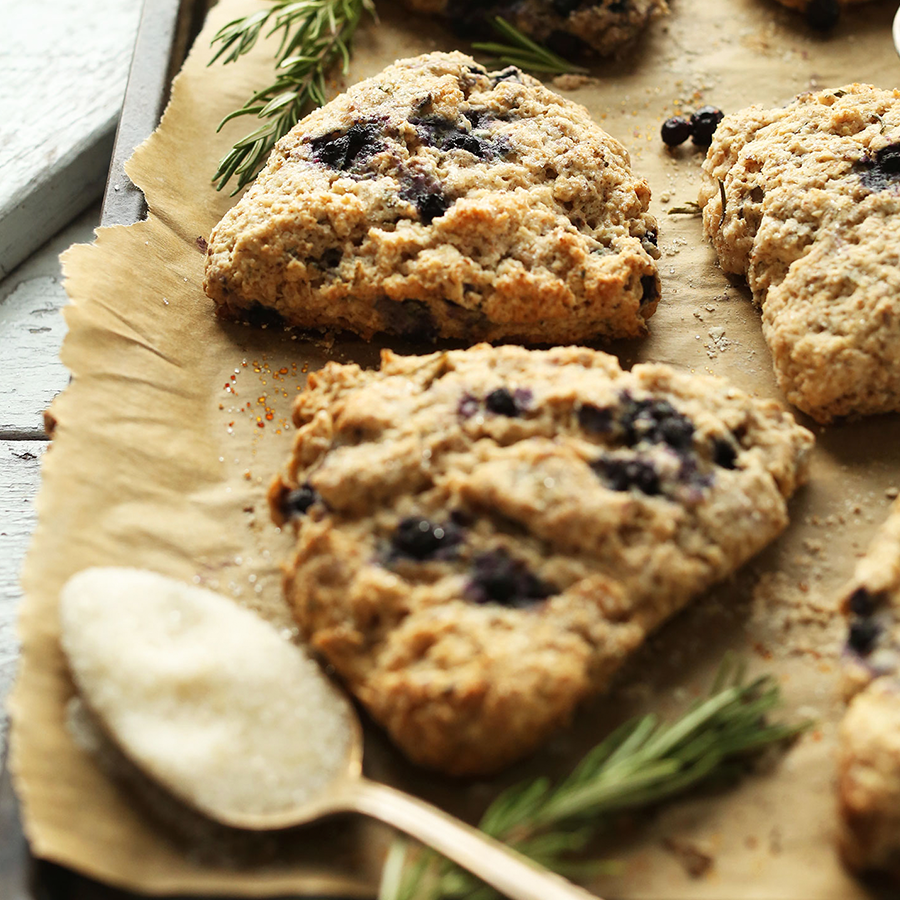 Parchment-lined baking sheet filled with homemade Rosemary Blueberry Scones