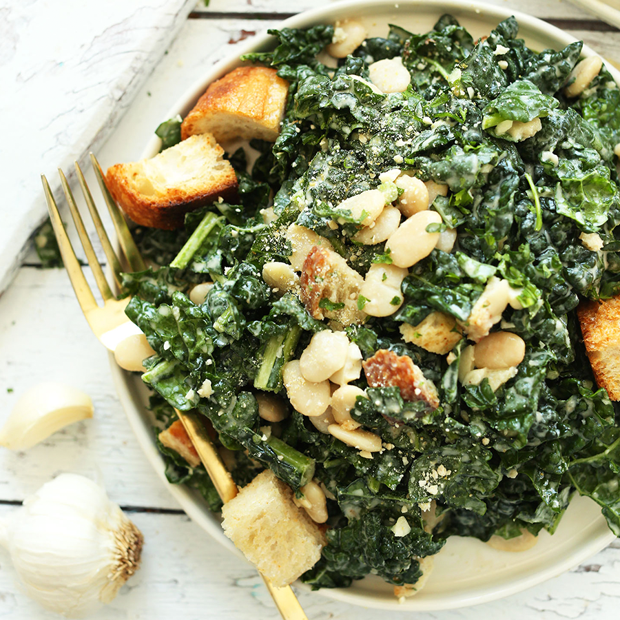 Big plate of our Amazing Lemony Garlic Kale Salad with Butter Beans