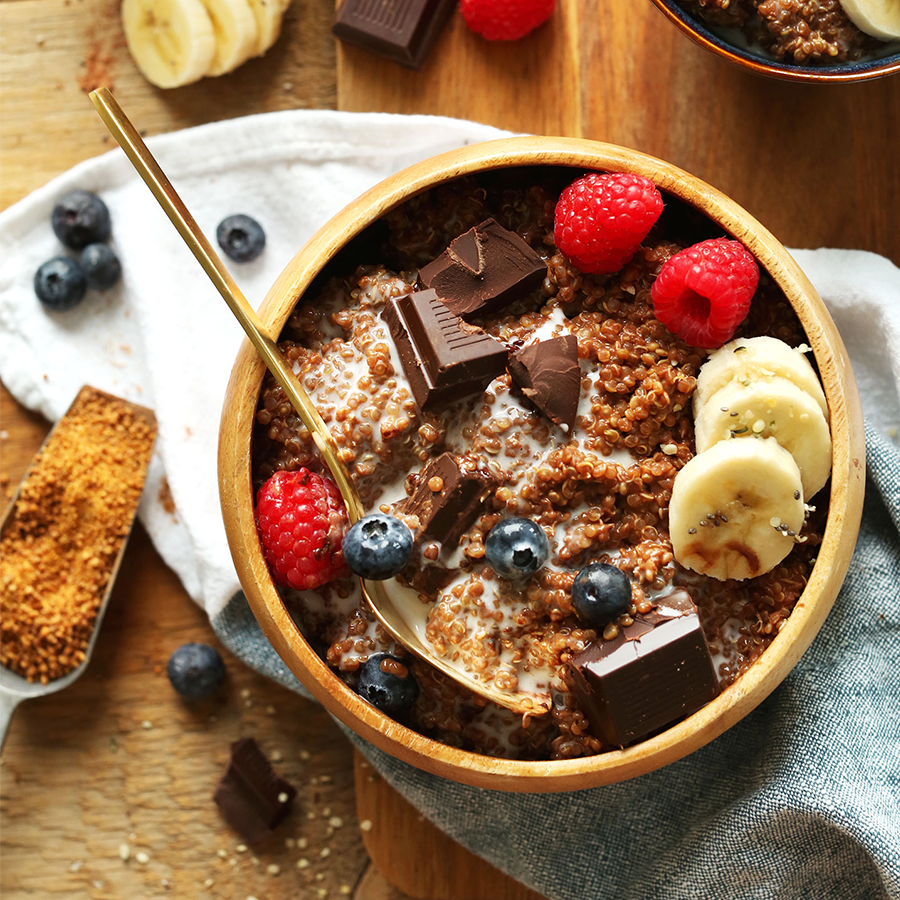 Wooden bowl filled with our Dark Chocolate Quinoa Breakfast Bowl recipe
