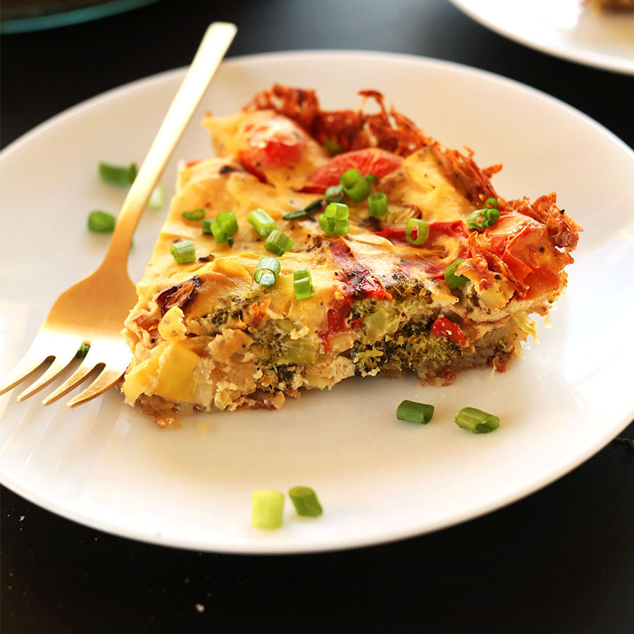Plate with a slice of Tofu Quiche sprinkled with sliced green onion