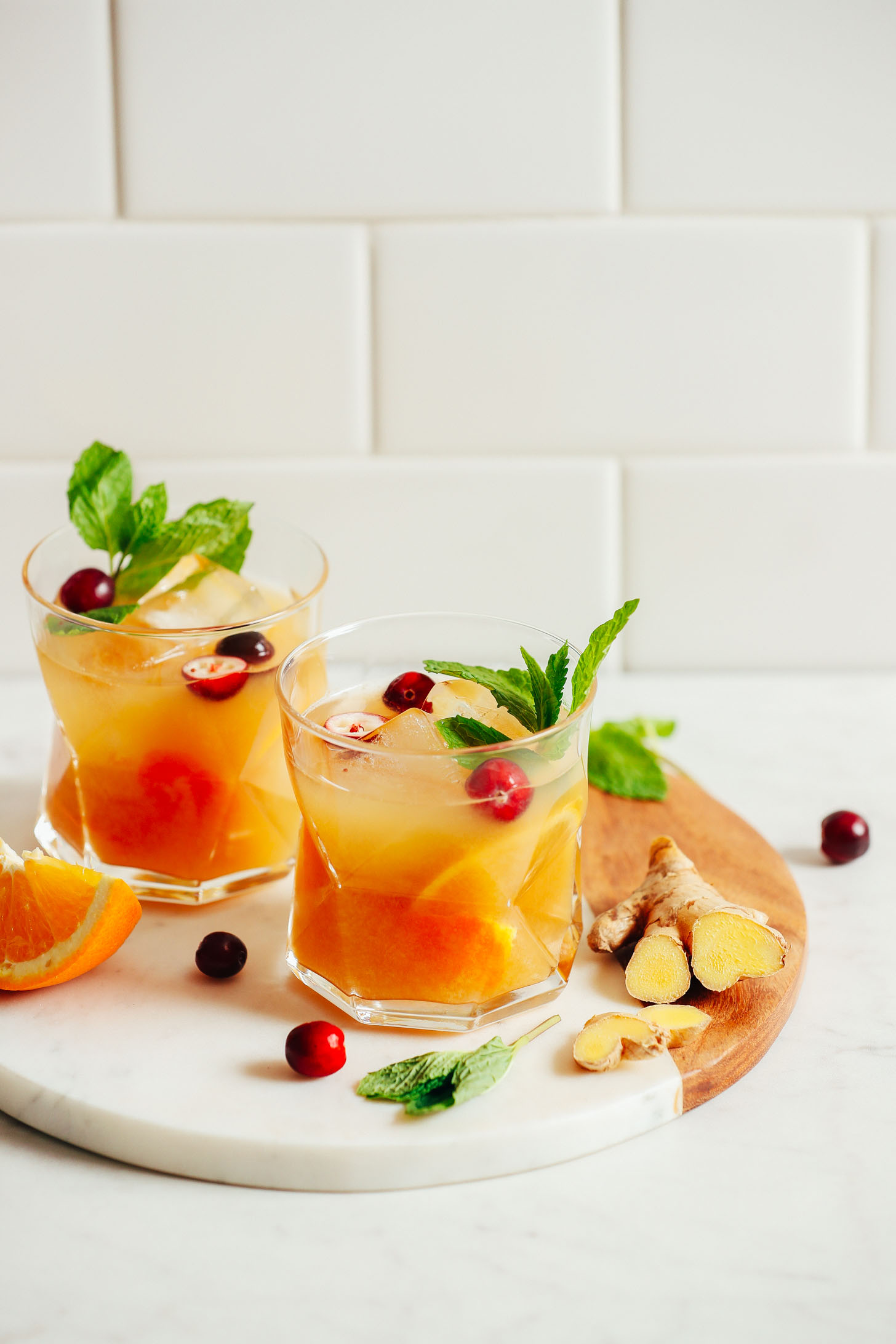Two glasses of refreshing, naturally sweetened Orange Whiskey Gingers with Mint