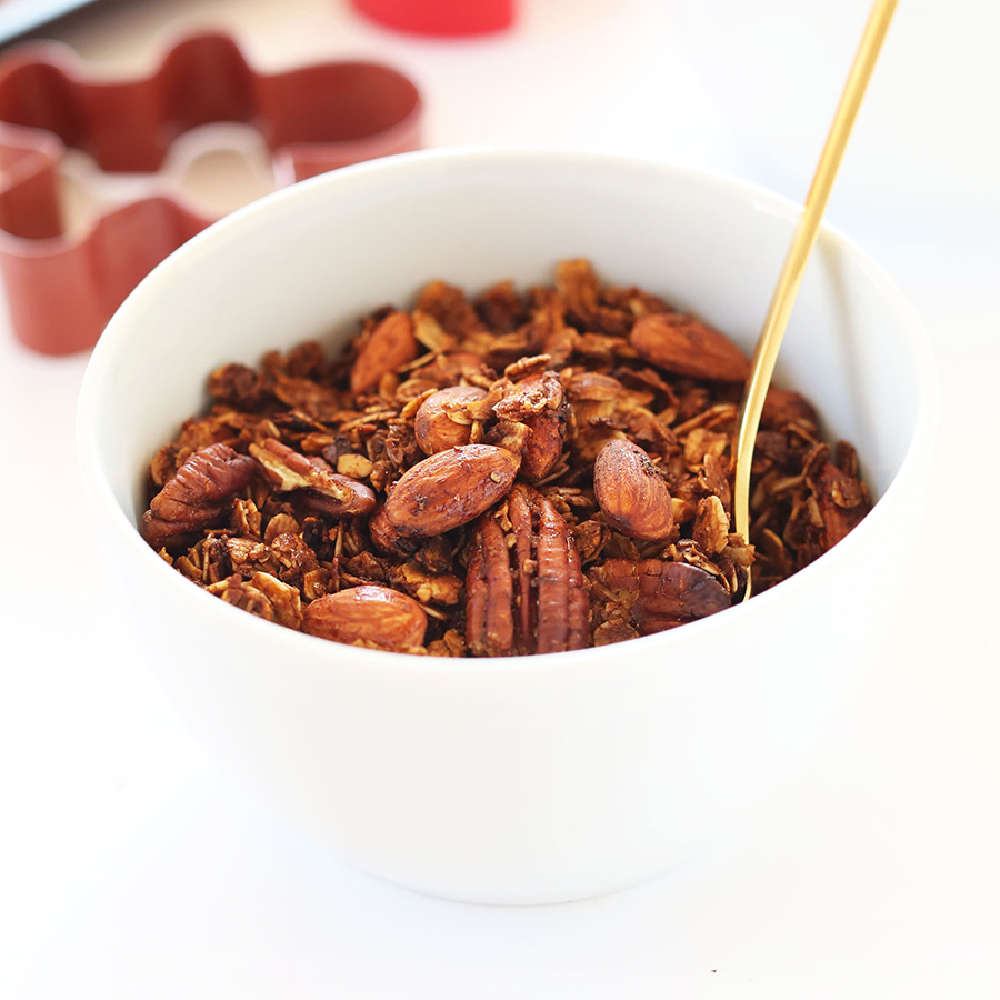 Bowl of Gingerbread Granola made with molasses and cinnamon