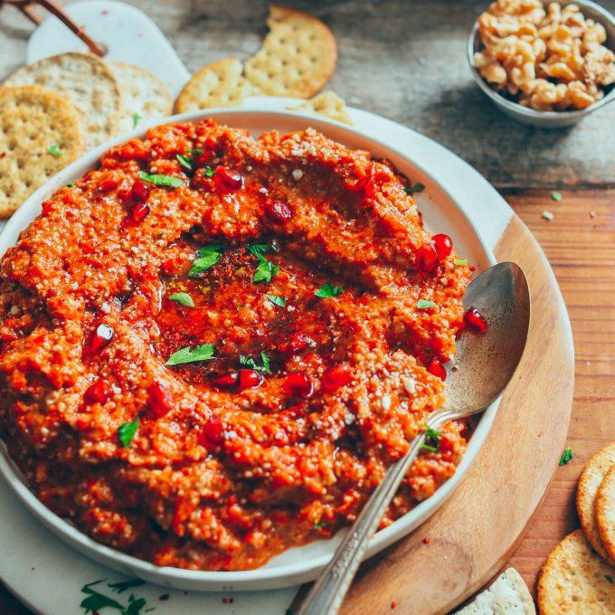 Smoky, spicy, and slightly sweet Gluten-Free Muhamarra Dip with gluten-free crackers
