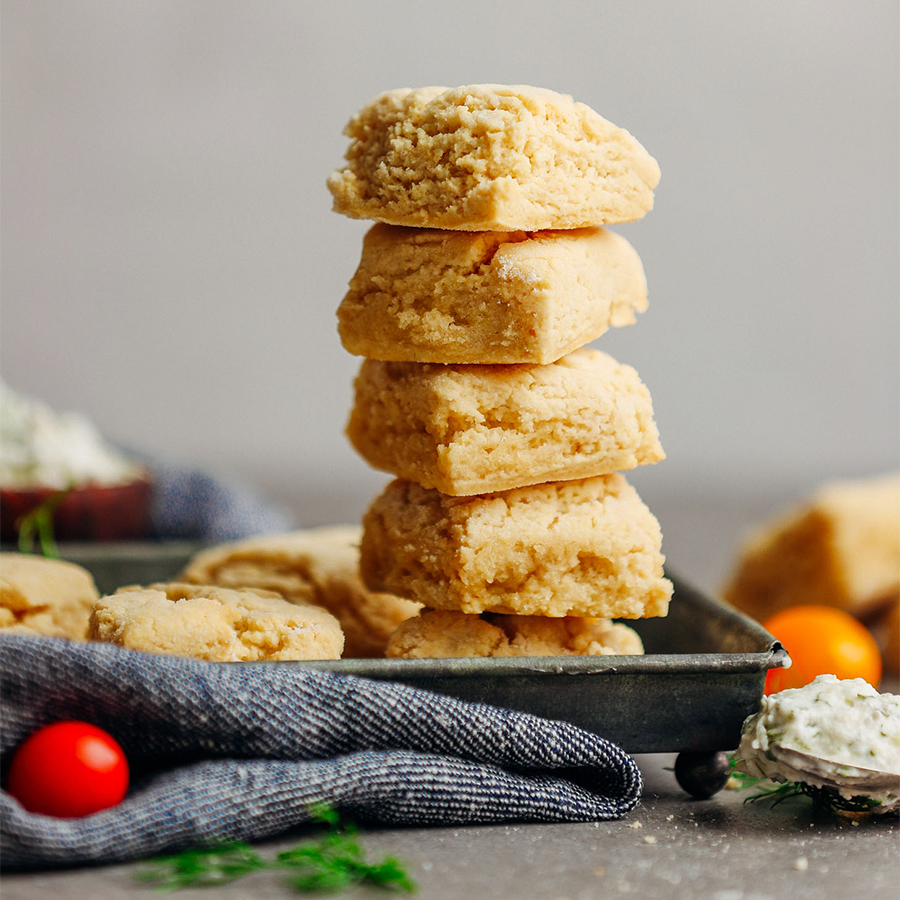Gluten-Free Vegan Biscuits stacked like a tower on a metal tray