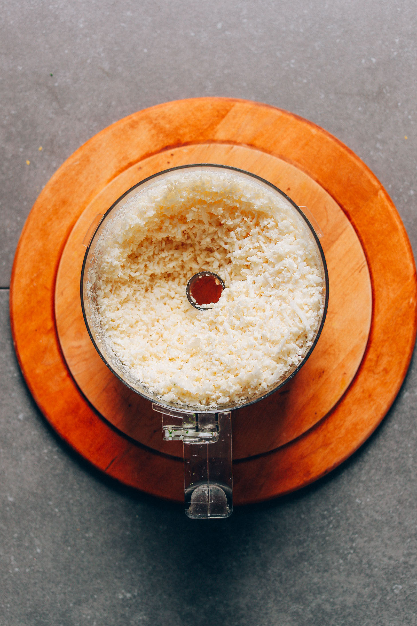Food processor filled with cauliflower rice