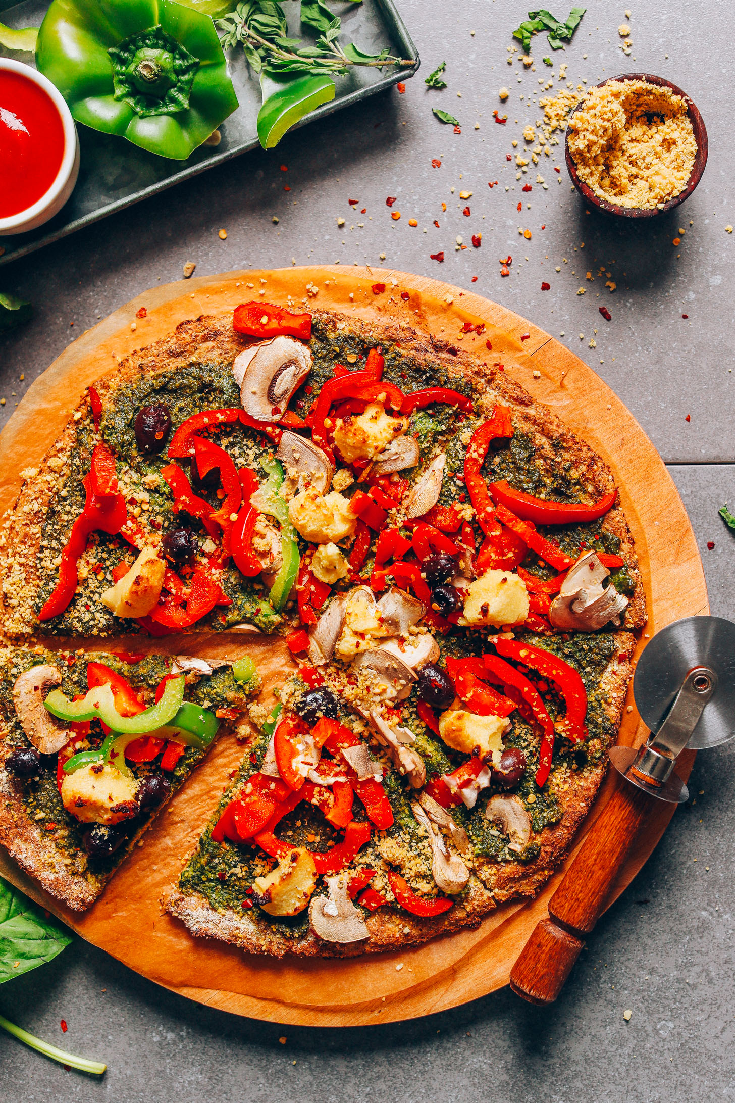 Sliced vegan gluten-free pizza made with a cauliflower crust
