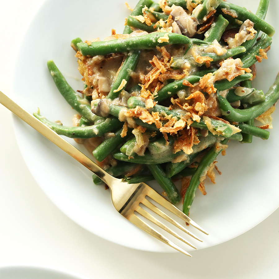 Plate with a serving of our creamy and flavorful Green Bean Casserole for a Thanksgiving side dish