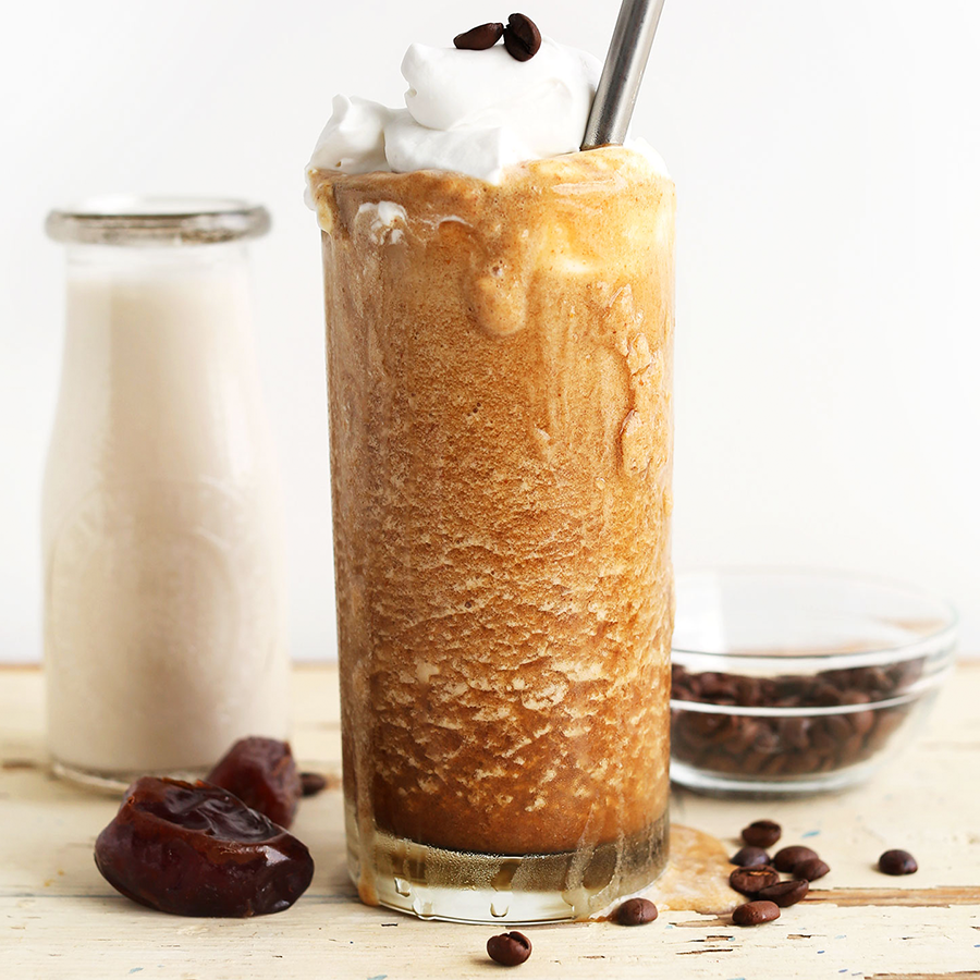 Large overflowing glass of our homemade gluten-free vegan Caramel Frappuccino