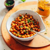 Bowl of our EASY Crispy Roasted Chickpeas perfect for snacking or topping plant-based salads