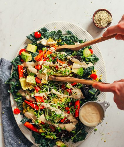 HEALTHY Loaded Kale Salad in just 30 minutes! Roasted and fresh veggies, sprouts, quinoa, and tahini dressing! #dinner #vegan #glutenfree #salad #healthy #minimalistbaker #recipe