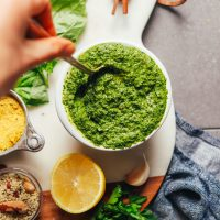 HEALTHY Super Green Vegan Pesto! BIG flavor, 10 minutes, 1 bowl, SO delicious. #vegan #glutenfree #plantbased #sauce #pesto #greens #minimalistbaker #recipe
