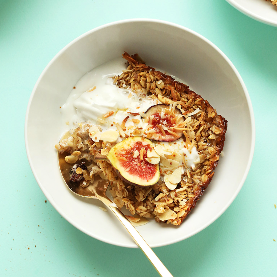 Big bowl of our healthy Toasted Coconut Baked Oatmeal recipe topped with fresh figs