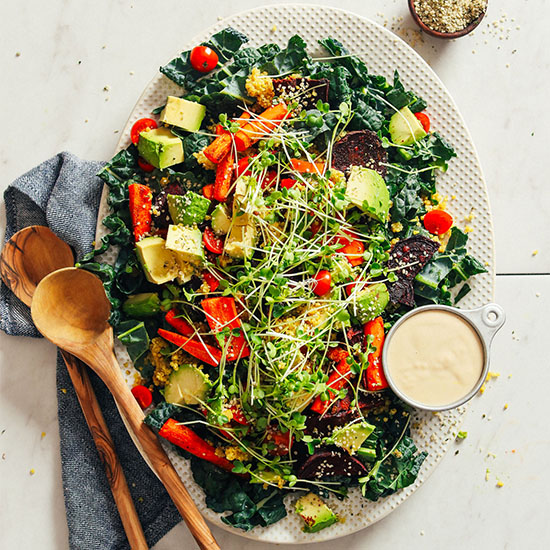 Platter filled with our healthy Loaded Kale Salad recipe