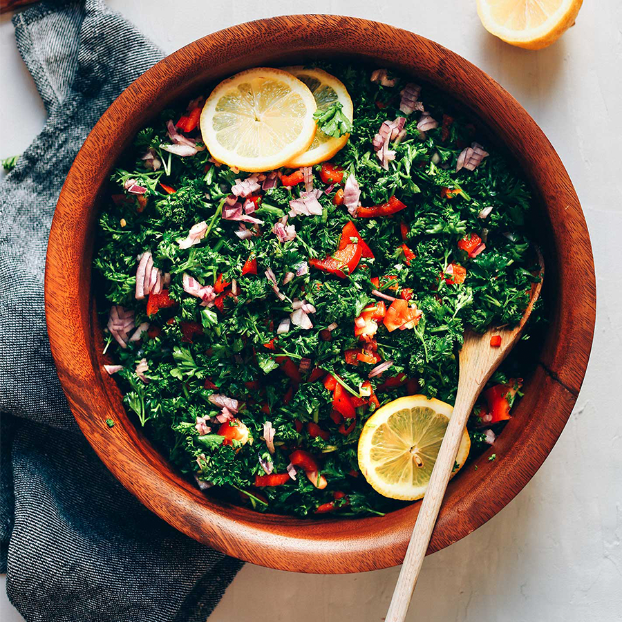 Wood salad bowl filled with our detoxifying Grain-Free Tabbouleh Salad recipe