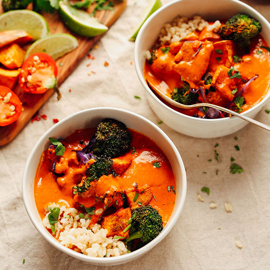 Two bowls of our Rich Red Curry served over brown rice