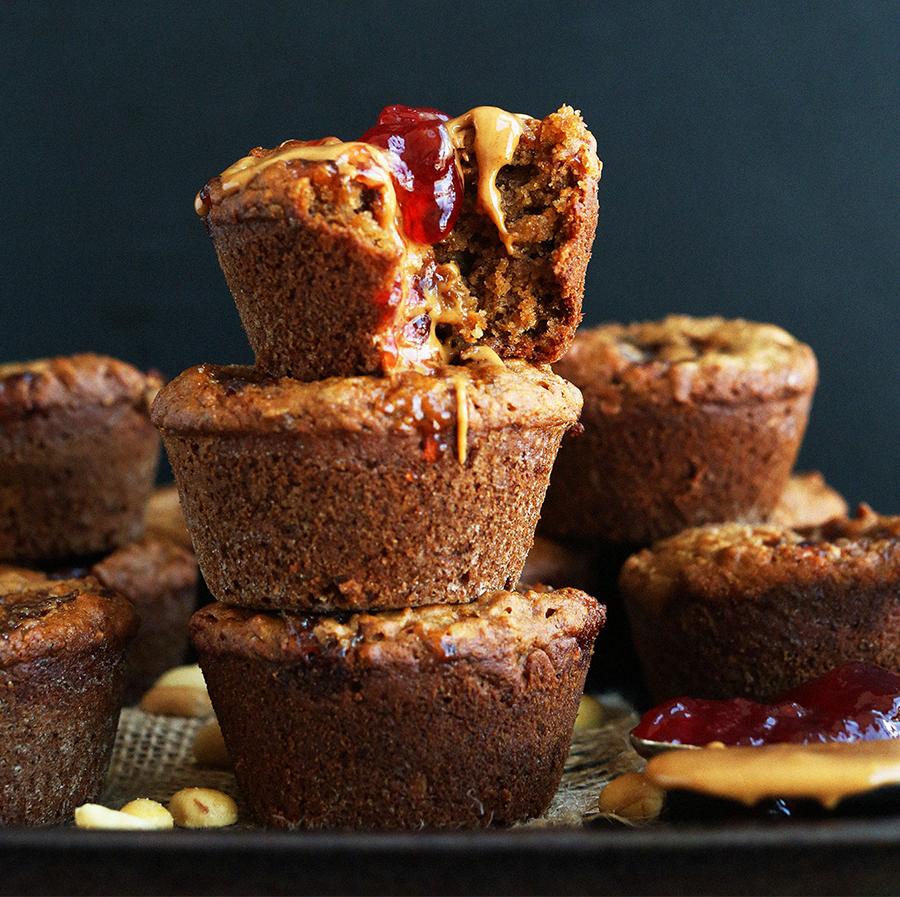 Batch of gluten-free PB&J Muffins stacked on a platter