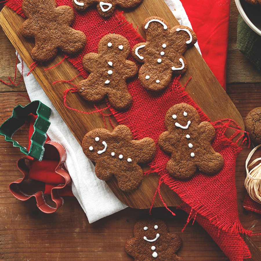 Vegan Gluten-Free Gingerbread Cookies on a wood cutting board