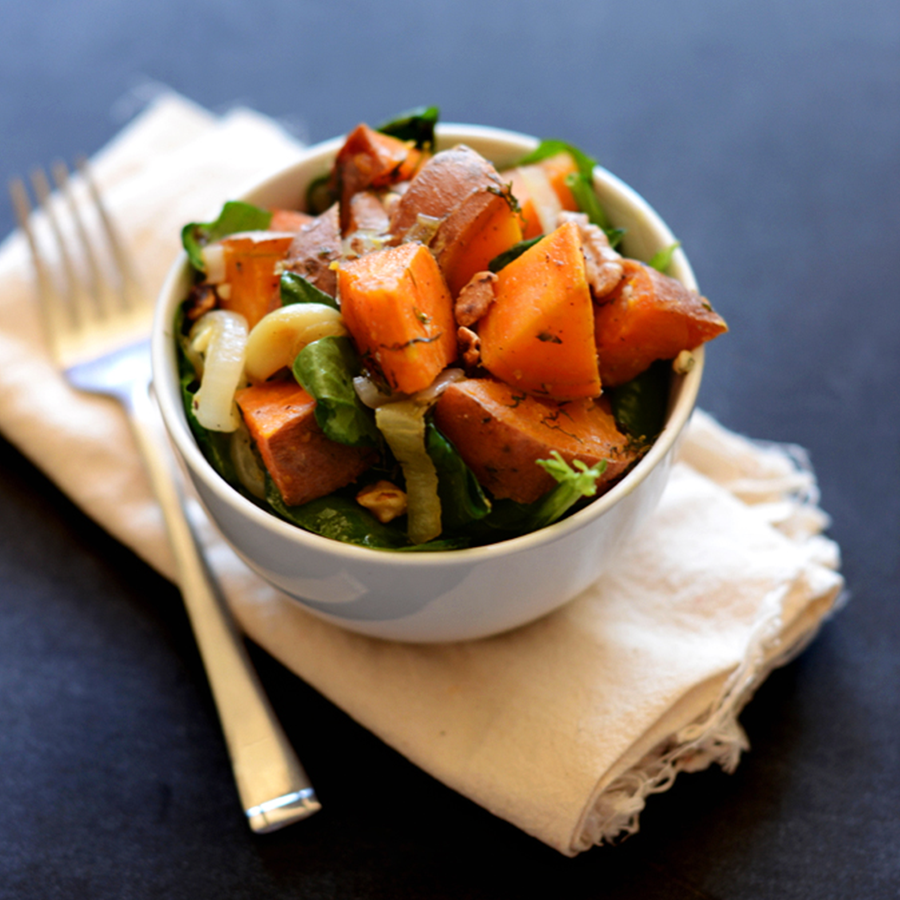 Bowl of our Warm Sweet Potato Dill Spinach Salad recipe