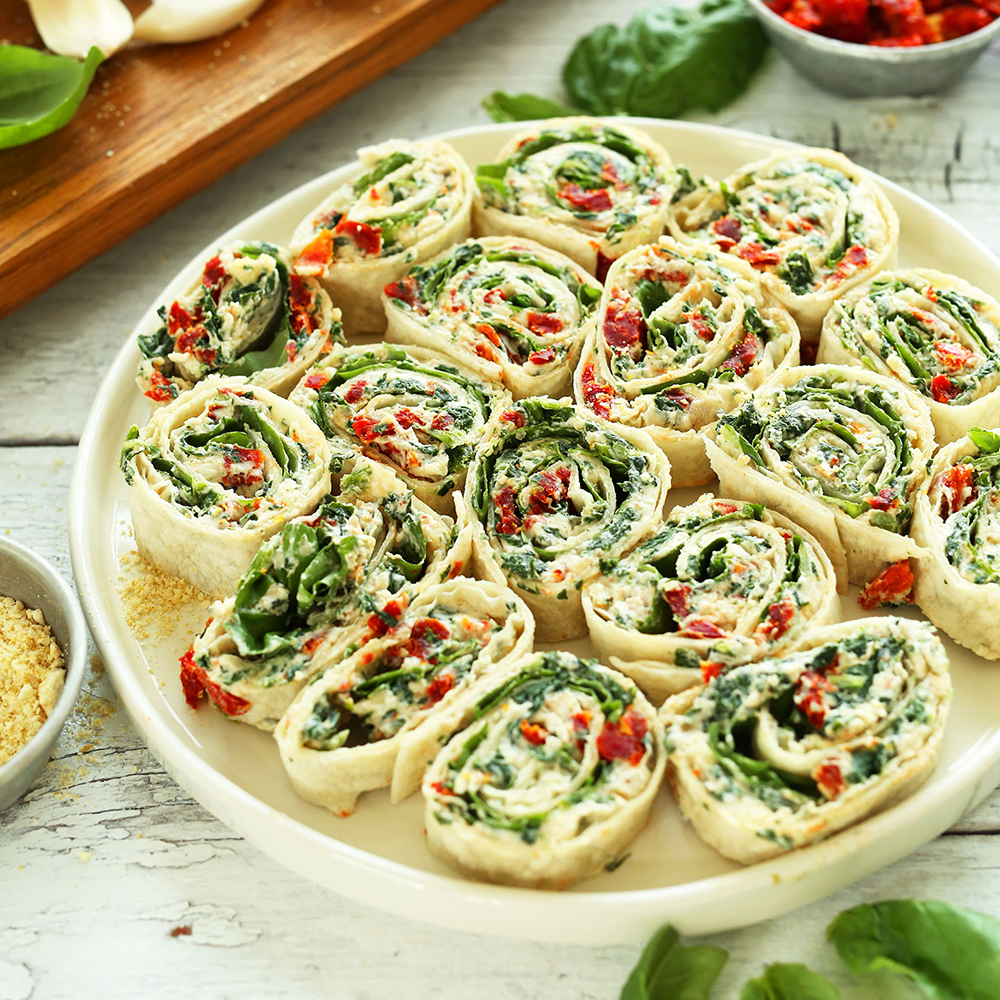 Plate of Sun-dried Tomato and Spinach Pinwheels for a simple Plant-Based Super Bowl Snack