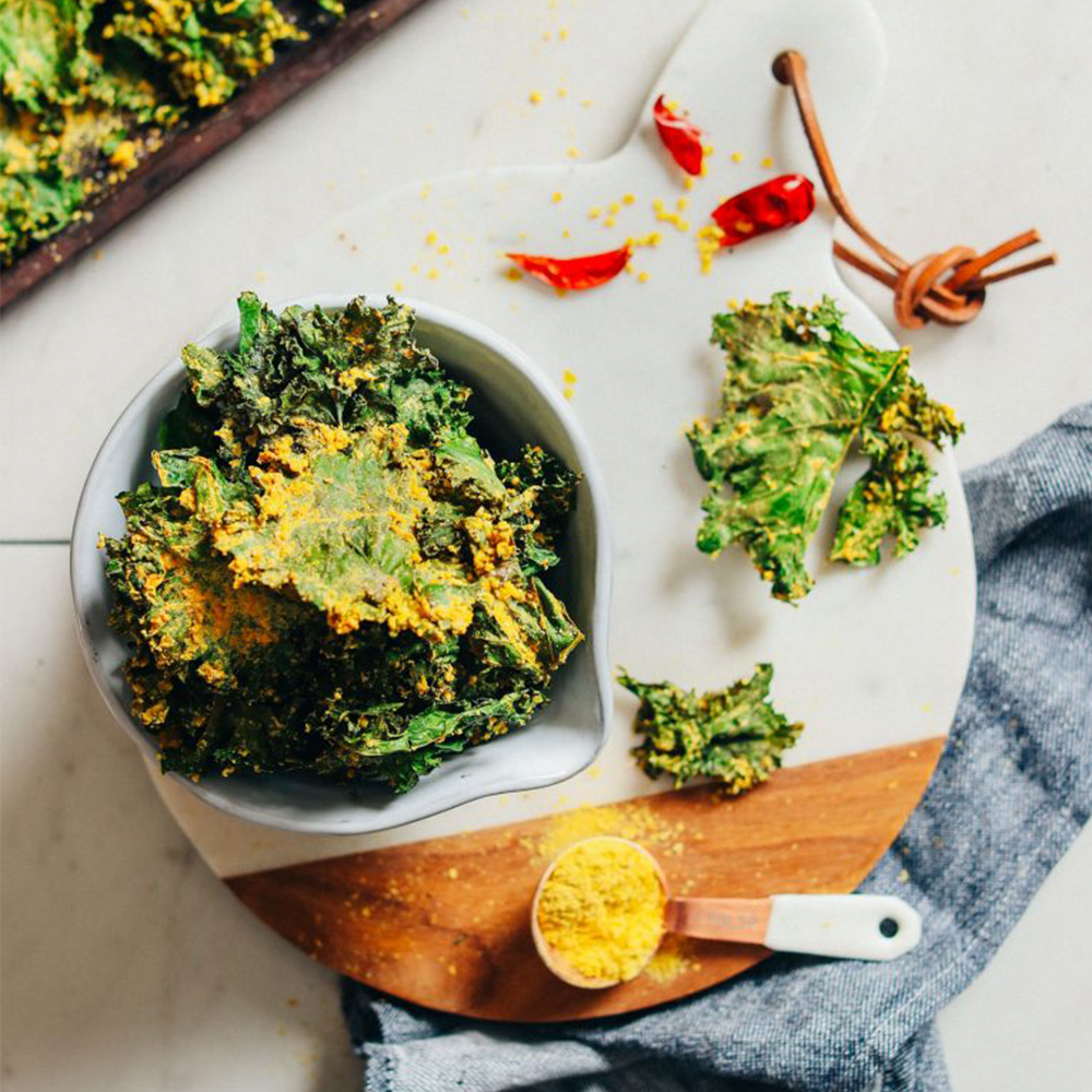 Bowl of homemade Kale Chips for a Plant-Based Super Bowl Snack Idea