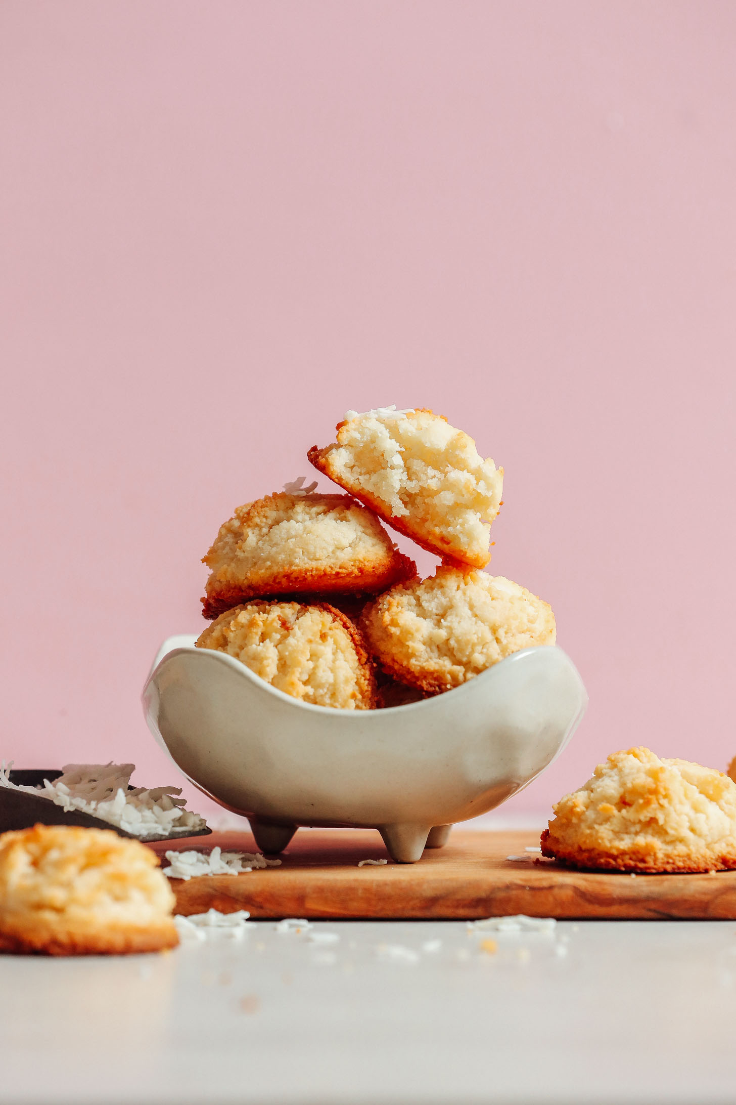 Bowl of stacked Vegan Coconut Snowball Cookies for a delicious gluten-free dessert