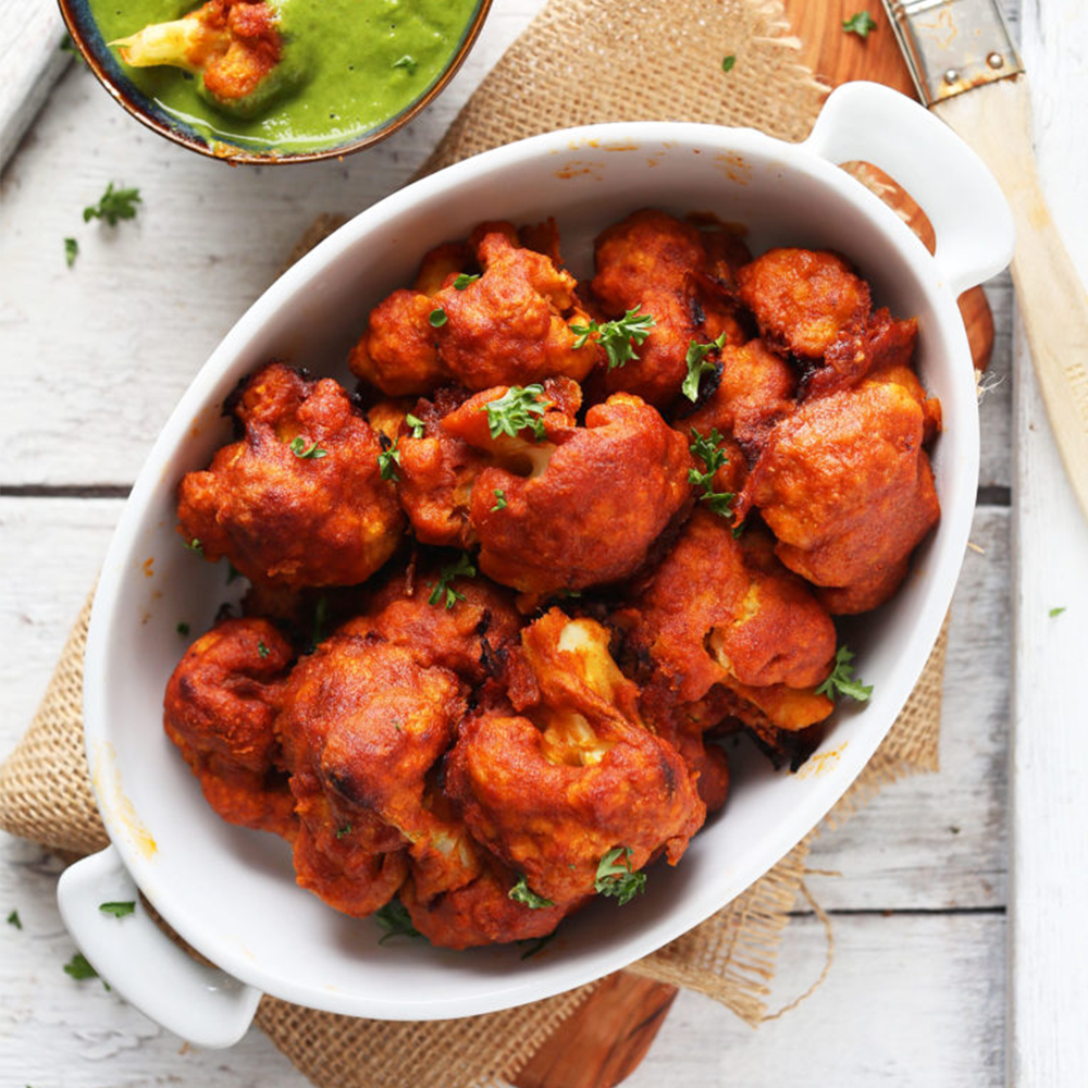 Dish of Red Curry Cauliflower Wings for our Plant-Based Super Bowl Snacks recipe