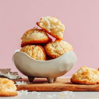 Bowl piled high with a batch of Gluten-Free Vegan Coconut Snowball Cookies