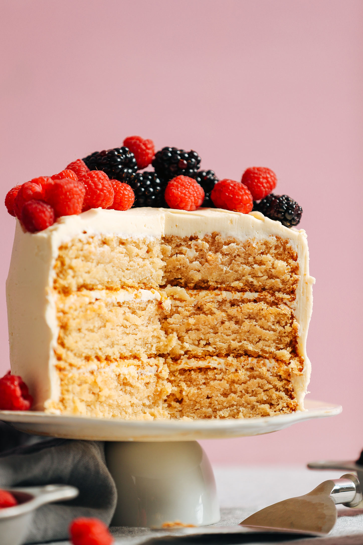 View of the cake layers in our 1-Bowl Vegan Gluten-Free Vanillla Cake topped with fresh berries