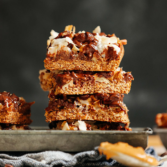 Tray stacked tall with homemade Vegan 7-Layer Bars