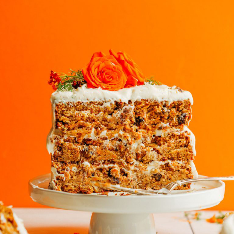 Carrot cake on a platter as a bonus dessert recipe in our Plant-Based 1-Pot Dinners roundup