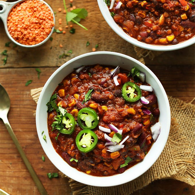 Bowls of our Lentil and Black Bean Chili for our roundup of Plant-Based 1-Pot Dinners