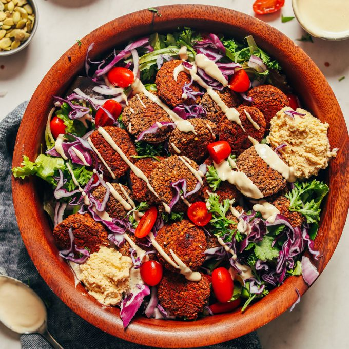 Big bowl of fresh vegetables and Black Bean Quinoa Falafel for a delicious gluten-free plant-based meal