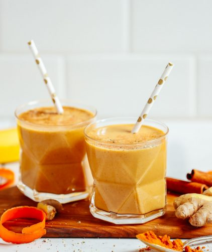 Two glasses of our healthy vegan golden milk smoothie