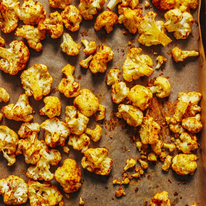 Baking sheet filled with Curried Roasted Cauliflower for our tutorial on How to Roast Cauliflower