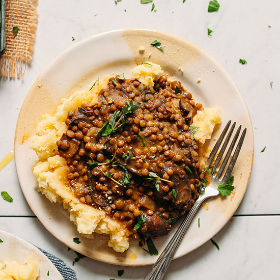 Plate of Lentil Mushroom Stew Over Mashed Potatoes