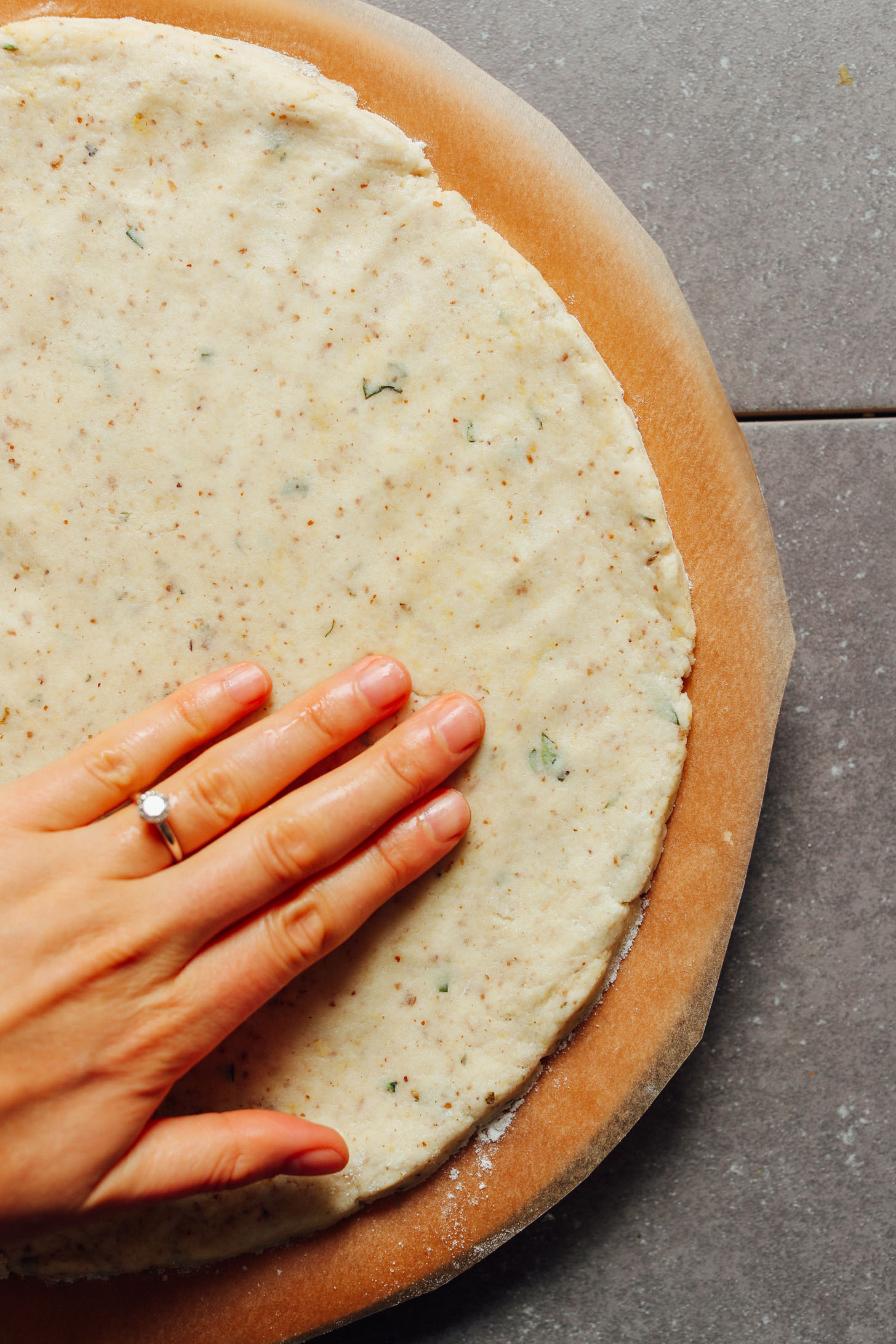 Flattening out the dough for our vegan Gluten-Free Pizza Crust