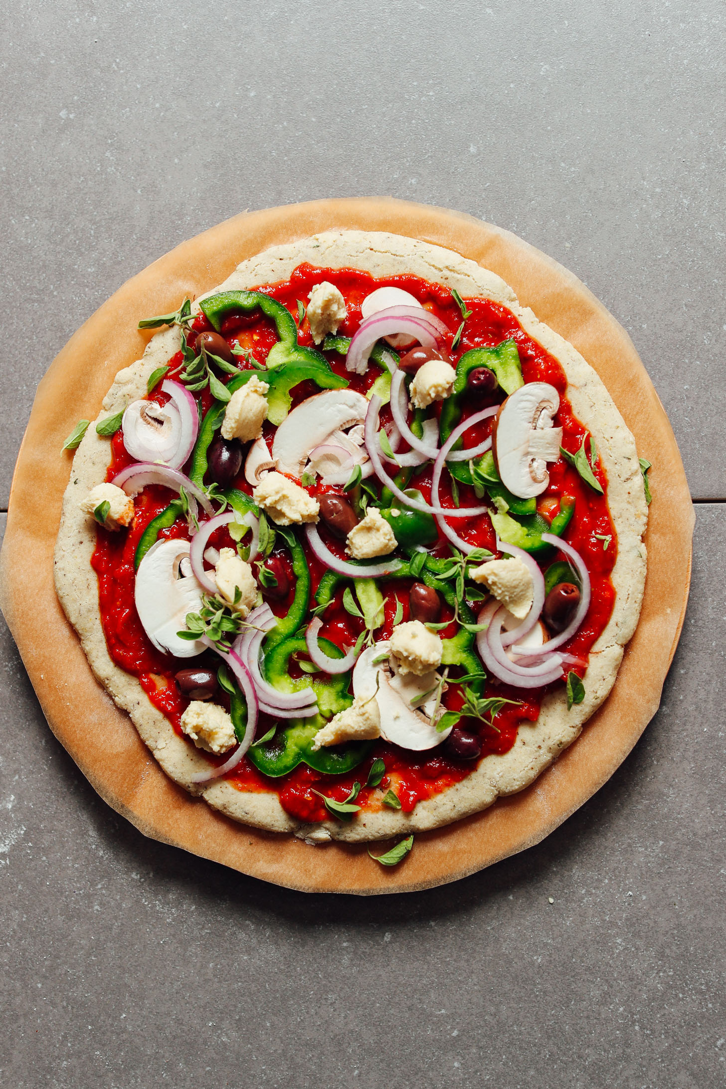 Gluten-Free Pizza Crust topped with marinara and fresh vegetables