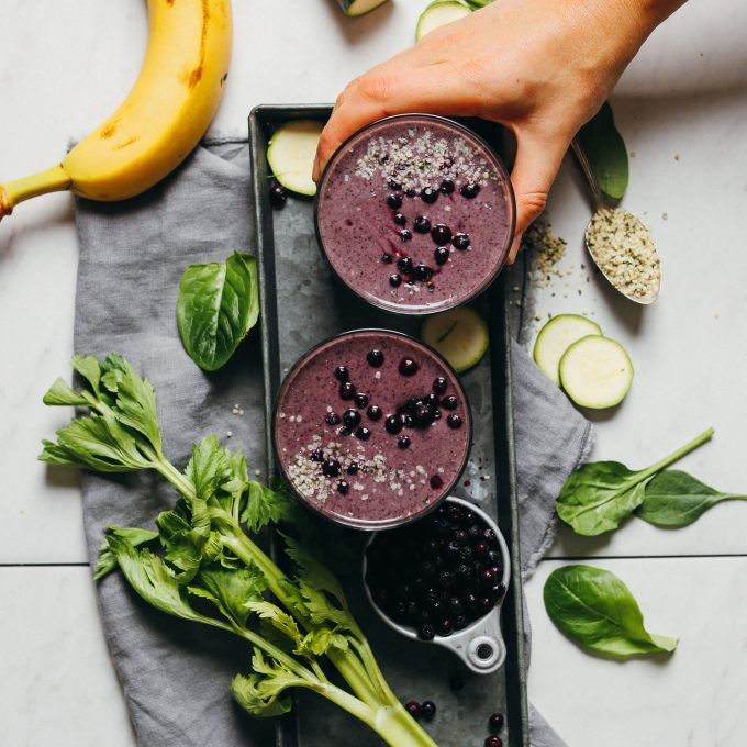 Grabbing a refreshing glass of this healthy gluten-free vegan Creamy Zucchini Blueberry Smoothie