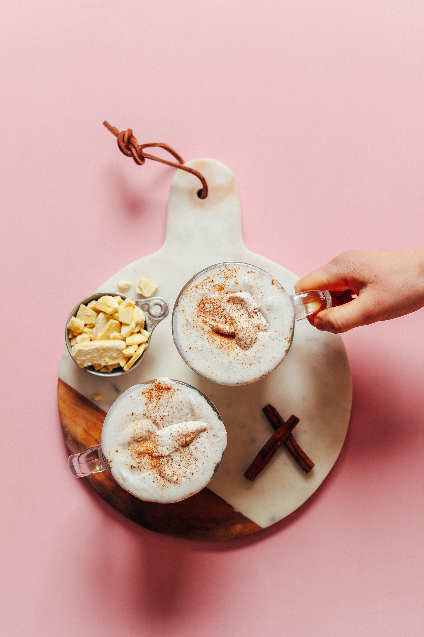Grabbing a mug of our delicious Vegan White Hot Chocolate for dessert