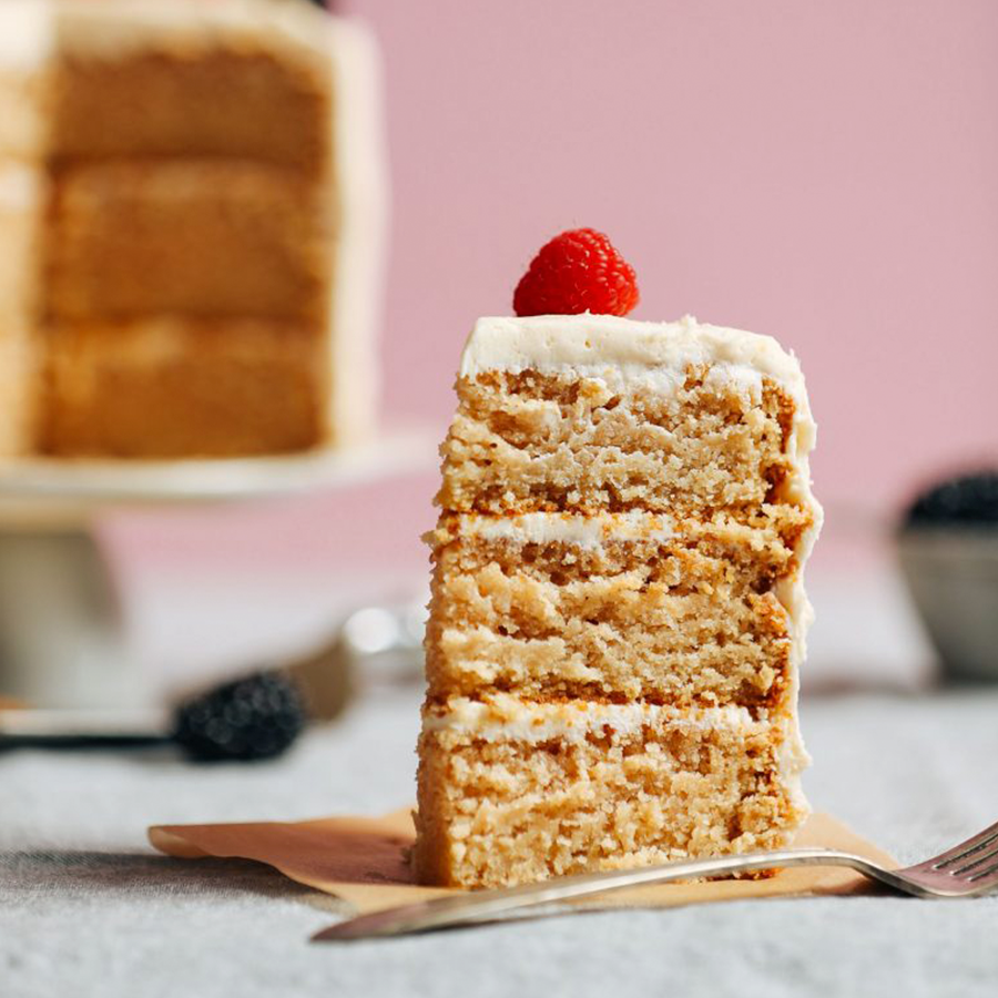 Tall slice of Gluten-Free Vegan Vanilla Cake as part of our roundup of Easy Vegan Easter Treats