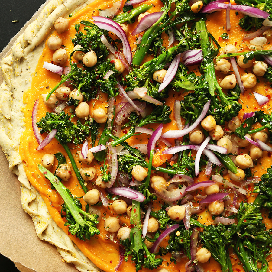 Close up shot of our Butternut Squash Vegetable Pizza recipe made with broccolini and red onion