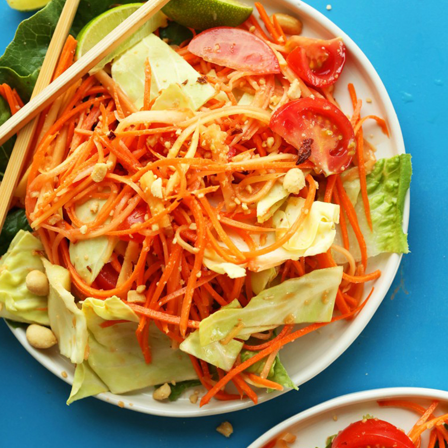 Chopsticks on a plate of Easy Thai Papaya Salad for our Spring-Inspired Recipes roundup